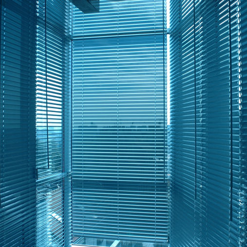 Office window with blue venetian blind