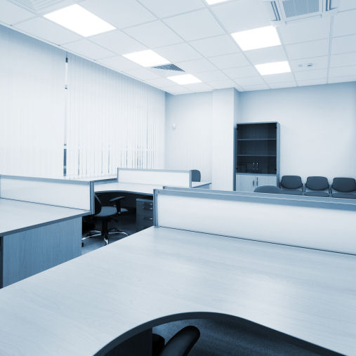 Office with solar reflective vertical blinds